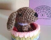 Amigurumi dog with rainbow basket and blanket