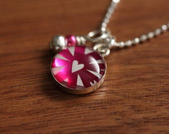 Tiny shiny pink heart necklace made from recycled Starbucks gift cards, sterling silver and resin.