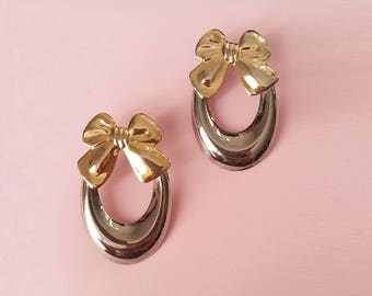 Cute vintage gold bow earrings, an silver hoop from the 90's