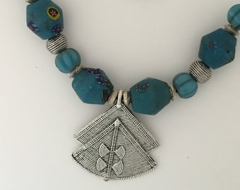African glass bead with silver plated pendant on leather
