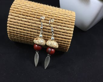 Ethnic earrings with brown acai seeds and cerebro de mono