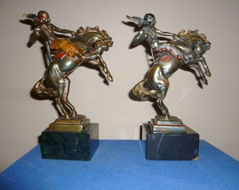 Art Deco period Pompein pair of bronze polychrome Native American on horses bookends by Armor Bronze USA circa 1930s