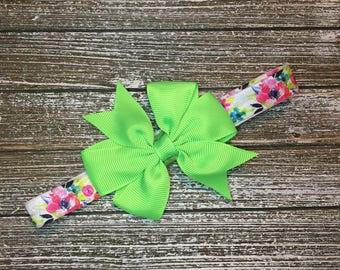 Spring bow on adjustable headband