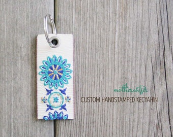 CUSTOM HANDSTAMPED white leather keychain with turquoise blue stitching by mothercuffer