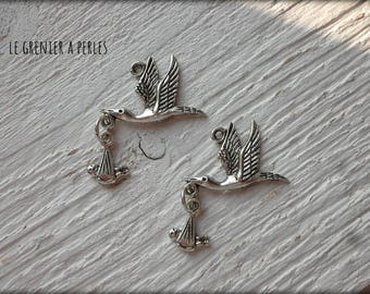 Stork and baby 2 x charm