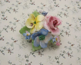 A very fine Coalbrook china period English vintage jewelry flower brooch of hand modeled and painted porcelain mixed flowers & green leaves