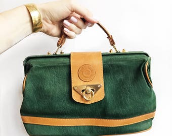 Hunter green and tan leather mini top handle doctor bag.