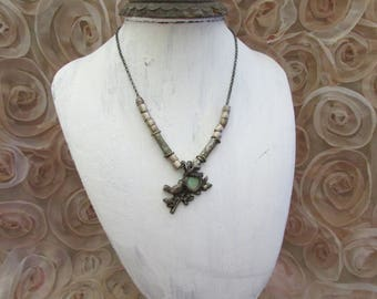Bird on branch on sterling silver necklace