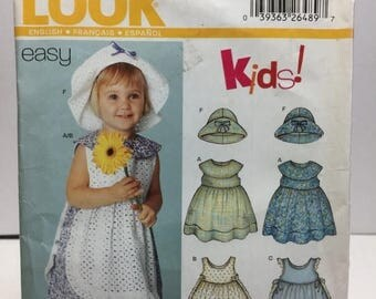 Christmas in July Simplicity New look 6255 Toddler Dress, Pinafore, Bloomers, Hat Sewing Pattern Size 0-L Brim Hat, Sleeveless Dress,Empire