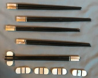 Handmade, Vietnamese Ebony Chopsticks with Brown Abalone shell and striped accents  comes with matching oval shaped, striped rests