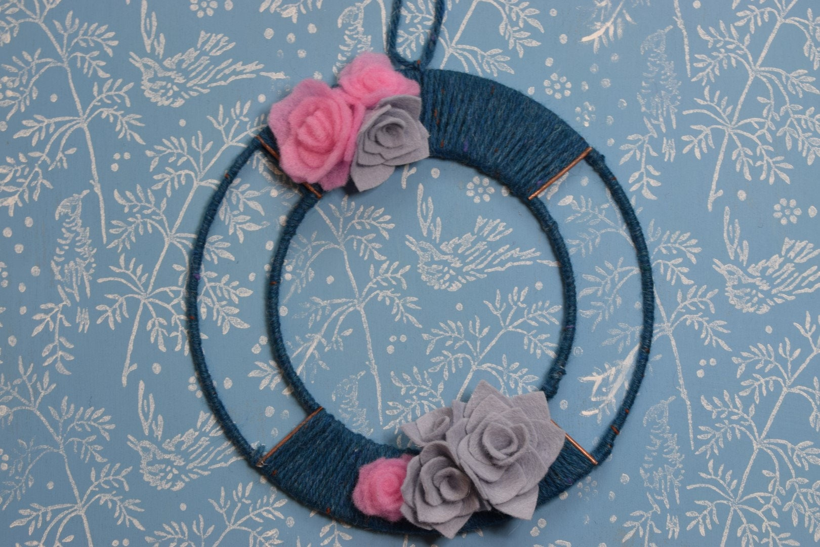 Metal wire Christmas (Holiday) wreath, wrapped in blue wool, with ...