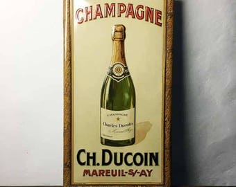 French Antique Embossed Metal Sign Champagne Ch. Ducoin - Mareuil sur Ay - Print by F. Champenois Paris - Early XXth Century