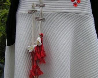 """bustles"" ecru and Red skirt"