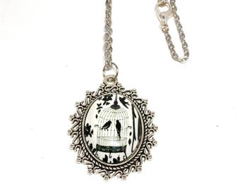 Silver cabochon bird cage and flowers black and white necklace