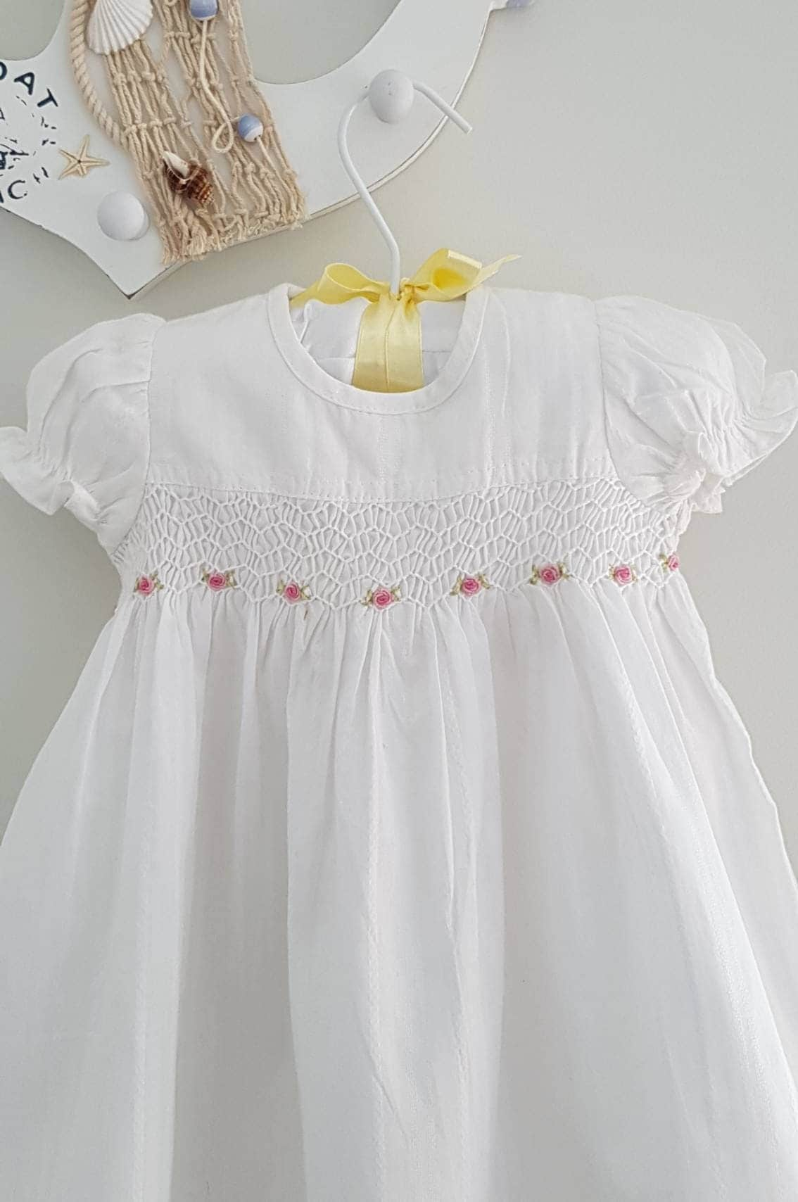 Hand Smocked Baby dress in white with hand embroidered roses