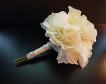 Beautiful rose and cala lily wedding bouquet.