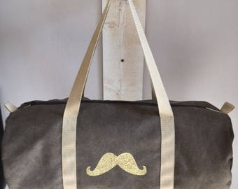 Brown canvas duffel bag