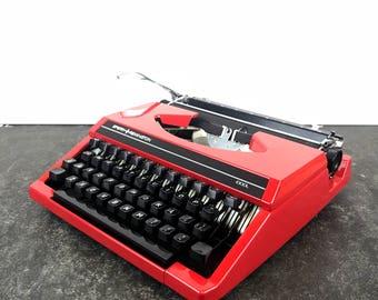 Vintage red Sperry-Remington Idool typewriter