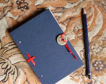 Hand bound notebook, blue with red ribbon and Chinese coin fastening, Coptic bound A6 blank book, red stitching, bullet journal