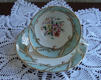 Paragon - Fine Bone China England - Vintage Tea Cup and Saucer - Teal Band , Floral Center with Gold Leaves and Trim