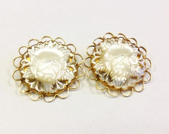 Huge, carved flower, mother of pearl disc, clip on earrings, circa 1950s to 1960s.