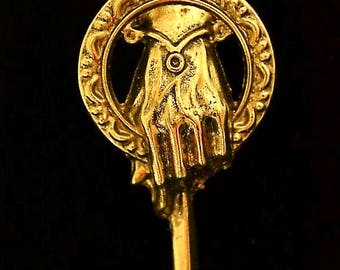 "The ""Hand of the King"" pin ""Game of Thrones"", Gold Finish and the ""Hand of the Queen"" pin, Silver Finish both have been worn by ""The Imp""."