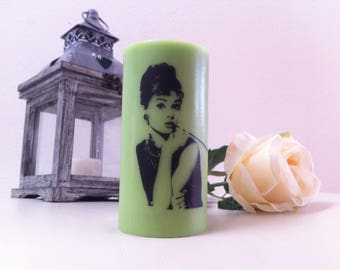 Apple scented candle with the image of Audrey Hepburn.