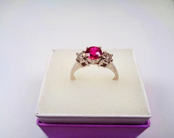 Ruby and Diamond Ring.  Genuine 14kt. Ring.  66 point Ruby 5mm. Round in White Gold with s I Diamond Accents.