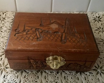 Carved wooden jewelry box with red interior Rustic East Asian Jewelry box