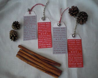 4 illustrated greeting in various languages Christmas tags