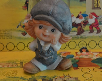 Girl Wearing Hat and Overalls Figurine