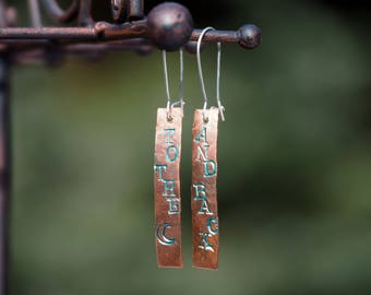 """Hand Stamped and Hammered Earrings. These say """"To the moon"""" on one ear, """"And Back"""" on the other ear. Copper and silver, handmade."""