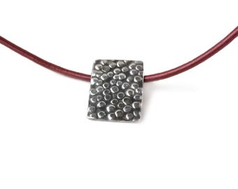 Ostrich sterling silver pendant on leather cord