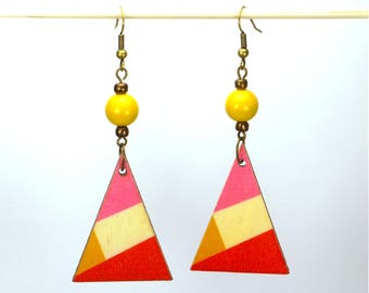 Triangles of yellow, pink and orange wood, brass and bronze and yellow glass bead earrings.