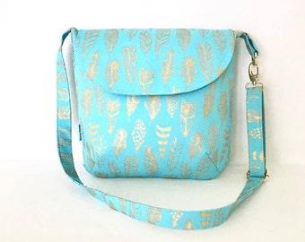 Crossbody Shoulder Messenger Handbag with adjustable strap zip closure and 2 slip pockets.