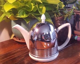 White Ceramic Tea Pot with chrome cozy