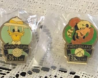 TWO Disney 35 years Anniversary Pins - Adventureland (Donald Duck) and Frontierland (Goofy)