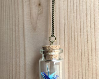 Bottle necklace with blue origami cranes