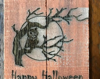 Happy Halloween with scary owl in tree