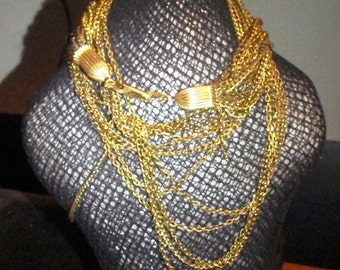 GOLD TONE 1920s multiple layer chain necklace. tassled tlike clasp