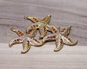 Ciondolo stella marina,ciondolo oro con inserti,stella marina oro,ciondolo collana.