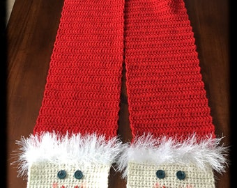 Unique handmade crocheted Santa scarf. Scarf has extra soft beard, twinkling button eyes, rosy cheeks and sweet smile. Fluffy hat, soft red.