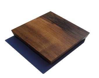 Small trivet or table centerpiece made of solid walnut
