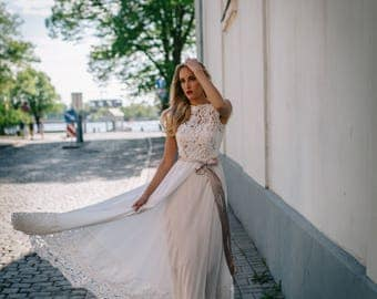 Ivory wedding gown, with lace top, belt and lace details