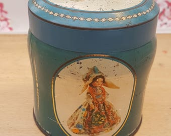 Vintage tin, Scribbans Kemp chocolate table fingers. Features dolls wearing the national dress of Germany, Portugal, Austria & China