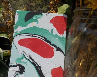 Watermarbled small coptic sketchbook journal red green black white