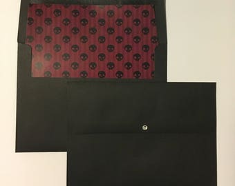 lined goth envelopes black with red/burgundy pinstripes and skulls. A7 size (5.25 x 7.25 inches or 13.3x18.2cm) fits 5x7 invitations.