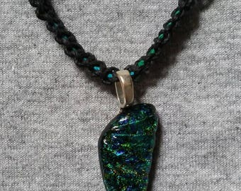 Hemp necklace with glass pendant.