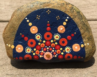 Mandala stone in oranges and blues