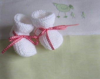 White baby booties in newborn - hand made knit